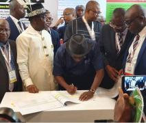 Nigeria-Engr. Simbi Kesiye Wabote signing