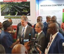 Nigeria-Engr Simbi Kesiye Wabote and Mr Sangster in a handsake