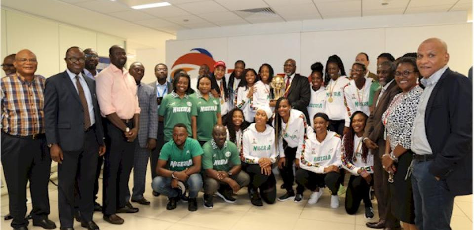Group photograph of D'Tigress and male Total staff